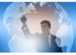 地球背景前成功商务男性高清图片
