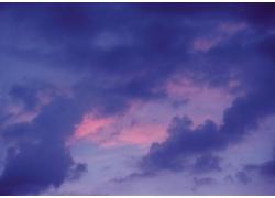 云彩遮蔽夕阳自然景观高清图片