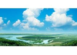 蓝天白云下的春天美景图片