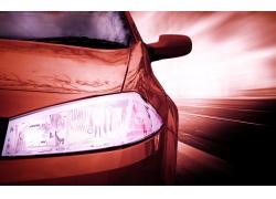 高速行驶时的轿车特写高清图片
