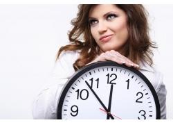 外国时尚女性和钟表高清图片