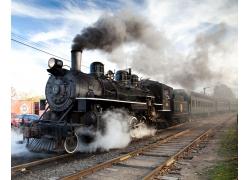 轨道上行驶的蒸汽火车高清图片