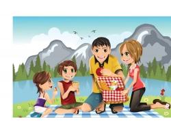 户外野餐的一家四口图片