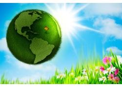 绿色地球与草地鲜花