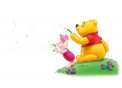 吹蒲公英的泰迪熊和小猪图片