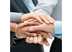 手叠在一起的职业人物