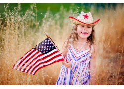 拿着美国旗的女孩